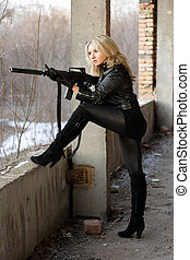 Blond girl with submachine gun