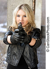 Brave young woman aiming - Brave young woman pointing a gun...
