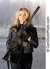 Armed beautiful young woman