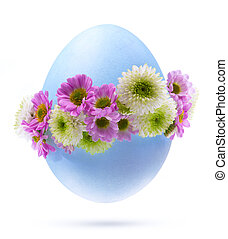 Art Easter egg decorated by flowers Isolated on white...