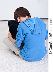 Teenager boy caught surfing the web