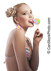 blond girl licking candy - beautiful young woman with blond...