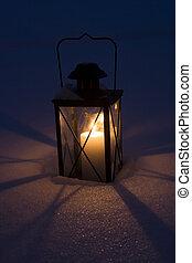 Lantern in the dark snow