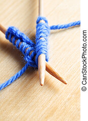 Knitted Stitches on Wooden Needles