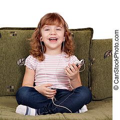 little girl listening music - happy little girl listening...