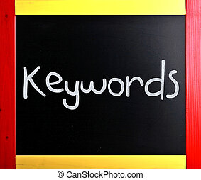 The word quot;Keywordsquot; handwritten with white chalk on...