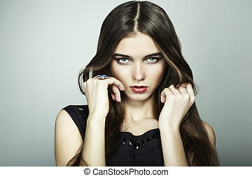 Fashion portrait of young beautiful woman. Close-up