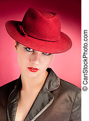 Portrait of sensuality stylish woman in red hat
