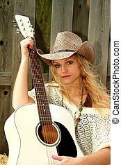 Cowgirl Musician - Cowgirl posing with her white guitar