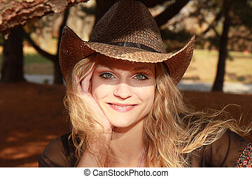 Sunlit Cowgirl Two - Cowgirl smiling and enjoying the...