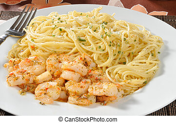 Shrimp scampi with pasta - Closeup of a plate of shrimp...