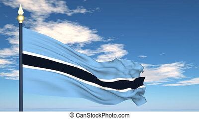 Flag Of Botswana on the background of the sky and flying...