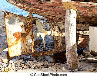 old boat - old rusry propeller on a wooden boat