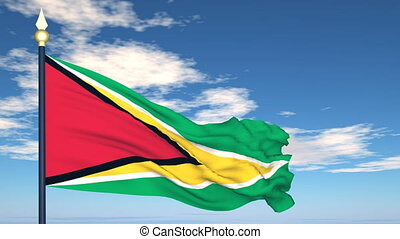 Flag Of Guyana on the background of the sky and flying...