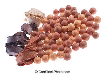 bronzing pearls with cream eyeshadows isolated on white...
