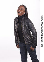 Young South African woman with a gregarious expression on white background.