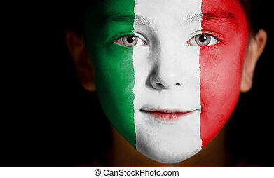 Child face painted with the flag of Italy Closeup