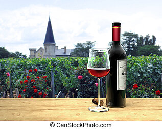 Red Wine in french M?doc - A bottle and a glass of Bordeaux...