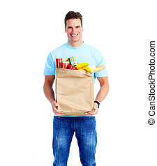 Young man with a grocery shopping bag.