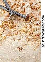 Nails and wood shavings closeup