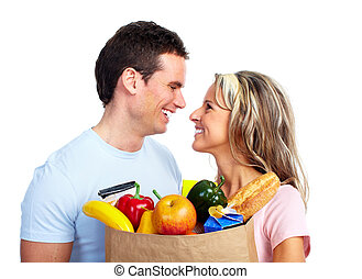 Young couple with a grocery shopping bag.
