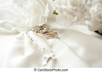 Wedding day - wedding rings isolated on light background