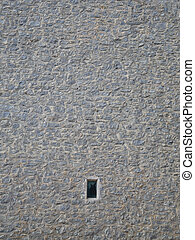 Small window in stone wall - Small window in an old tall...