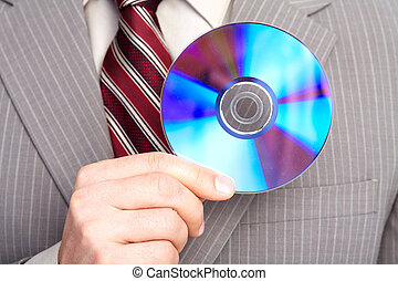 Businessman with a CD. Technology.