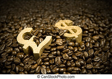 gold dollar and pound in coffee beans