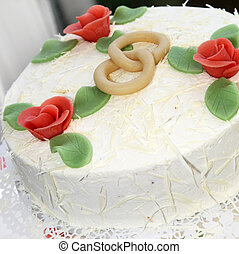 Rings On Wedding Cake - Detail of intertwined rings with...