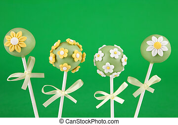 Flower cake pops - Four round mini cakes covered with...