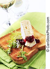 Toast and French cheese - Slice of toasted bread and French...