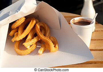Churros, chocolate