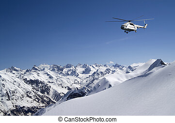 Helicopter in snowy mountains