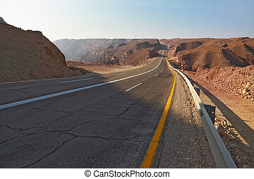 Magnificent highway in desert of Eilat in Israel. A sunset