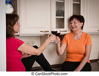 Happy life - mother and daughter drinking wine