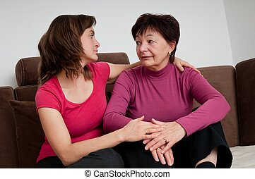Big problems - daughter comforts senior mother - Daughter...