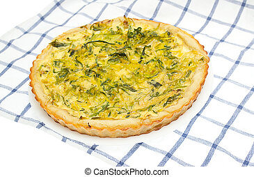 Onion tart on a plate with a background