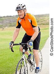 active senior man riding a bicycle