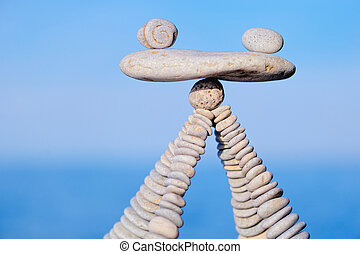 Unerring - Balancing of white pebbles on the top of piles