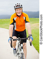 active senior man riding bicycle