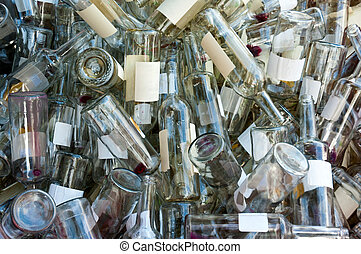 Empty wine bottles - A large heap of empty white wine...