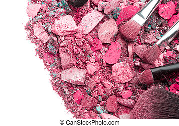 crushed eyeshadows with set of brushes isolated on white...