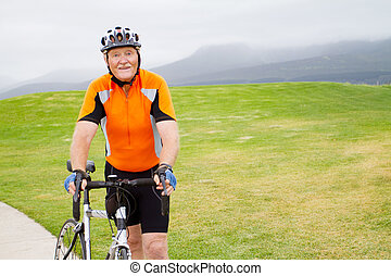 active senior male bicyclist portrait