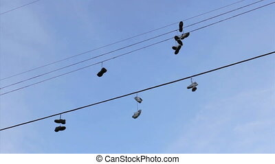 Running Shoes Hanging From Wires - A whole bunch of running...