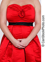 Woman in red dress - Photo of an unrecognisable woman in a...