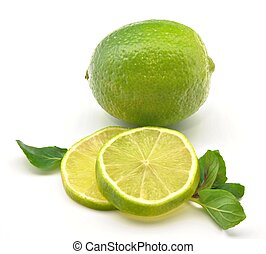 Lima along with lime slices with mint leaves surrounded by...