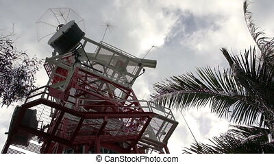 Communication tower - A red and white steel structured...