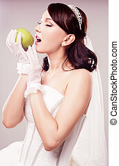 bride eating an apple - beautiful bride eating an apple,...