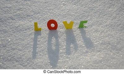 Valentine word love on snow